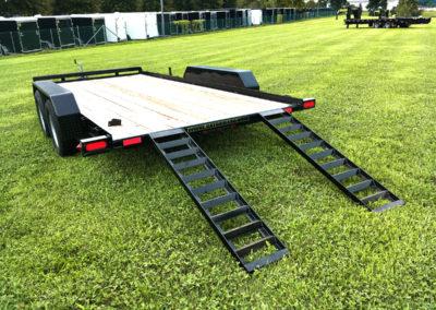 Car hauler trailer with slide-in ramps